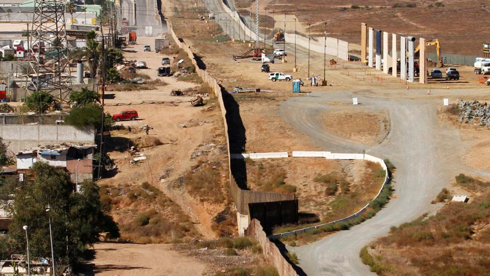 Prototypes (right) for US President Donald Trump's border wall with Mexico are shown near completion in this picture taken from the Mexican side of the border, in Tijuana, Mexico.