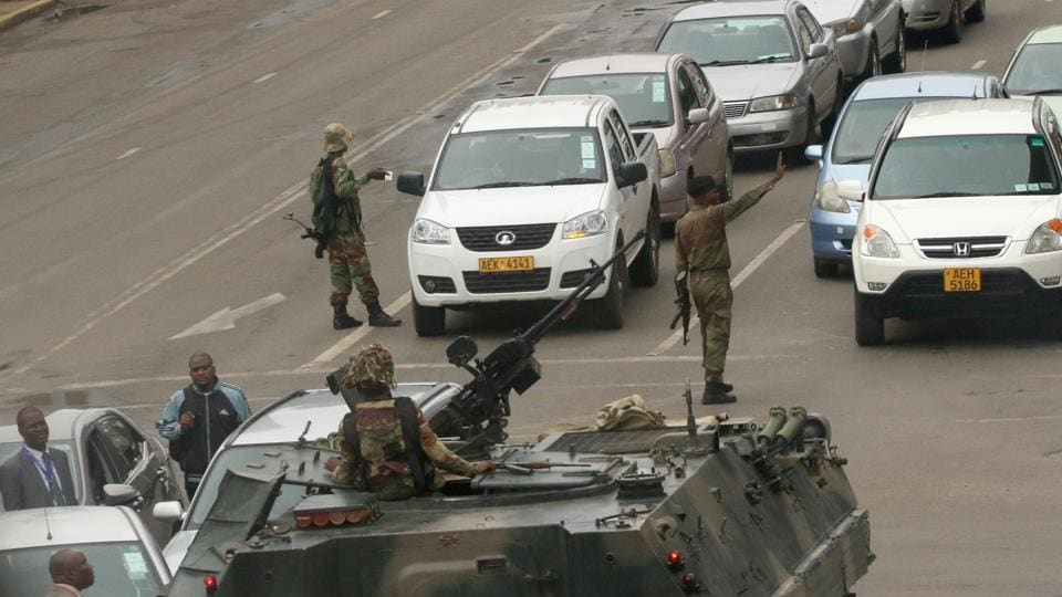 Soldiers patrol the streets of Harare, Zimbabwe on November 15, 2017. Military vehicles took to the streets of the Zimbabwe's capital and prolonged gunfire was heard near the presidential residence early on Wednesday as questions mounted over Robert Mugabe's grip on power, even as the army denied a coup. (Philimon Bulawayo / REUTERS)
