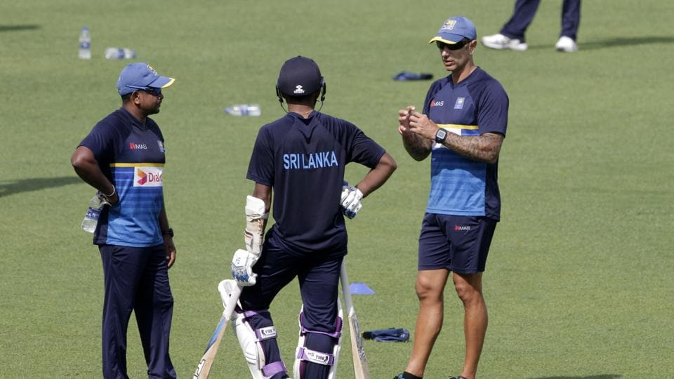 Sri Lanka coach Nic Pothas (R) talks with Rangana Herath (L) during a practice session ahead of the first Test.  (AP)