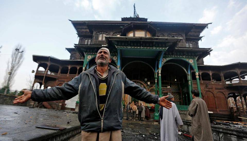 A man reacts after a fire damaged a portion of the shrine of Mir Syed Ali Hamdani, a Sufi saint, in Srinagar early Wednesday.
