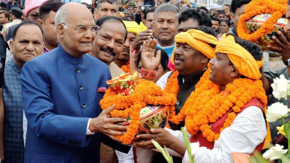 President Ram Nath Kovind being welcomed by tribals as he arrives to pay floral tributes at the statue of Birsa Munda in Ranchi on Wednesday.