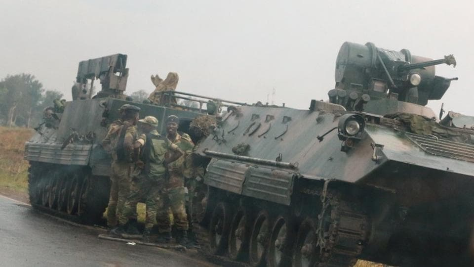 Soldiers stand beside military vehicles just outside Harare,Zimbabwe,November 14,2017.
