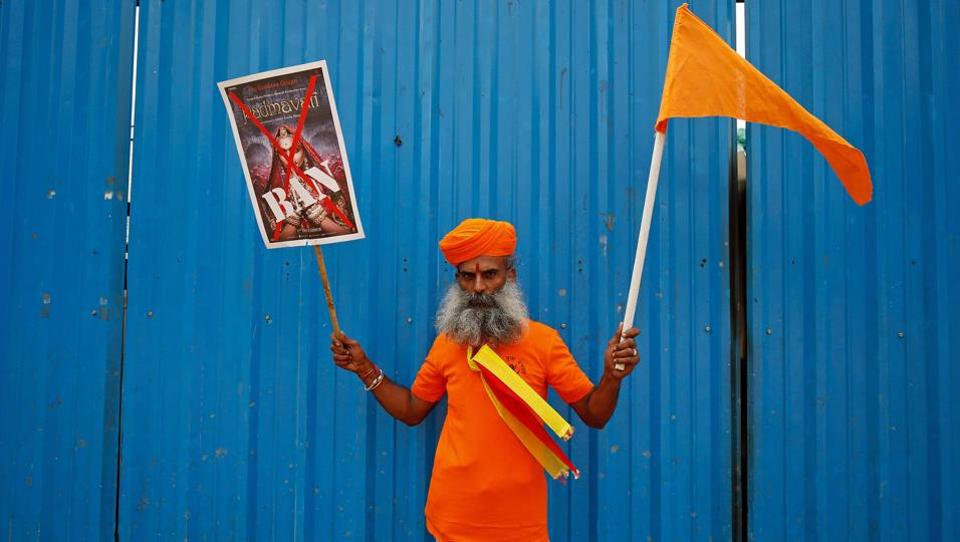 A demonstrator poses during a protest against the release of the upcoming Bollywood movie 'Padmavati' in Bengaluru.