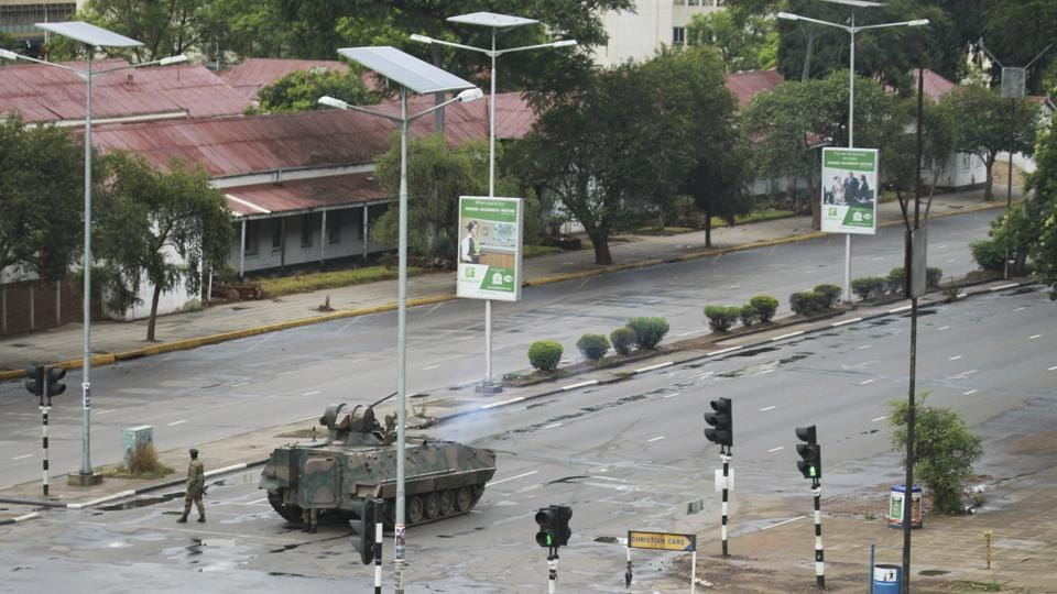 "A military tank is seen with armed soldiers on the road leading to President Mugabe's office in Harare. The military has detained finance minister Ignatius Chombo after seizing power in an attempt to root out ""criminals"" around President Mugabe who it said were causing social and economic suffering, a government source said. (Tsvangirayi Mukwazhi / AP)"