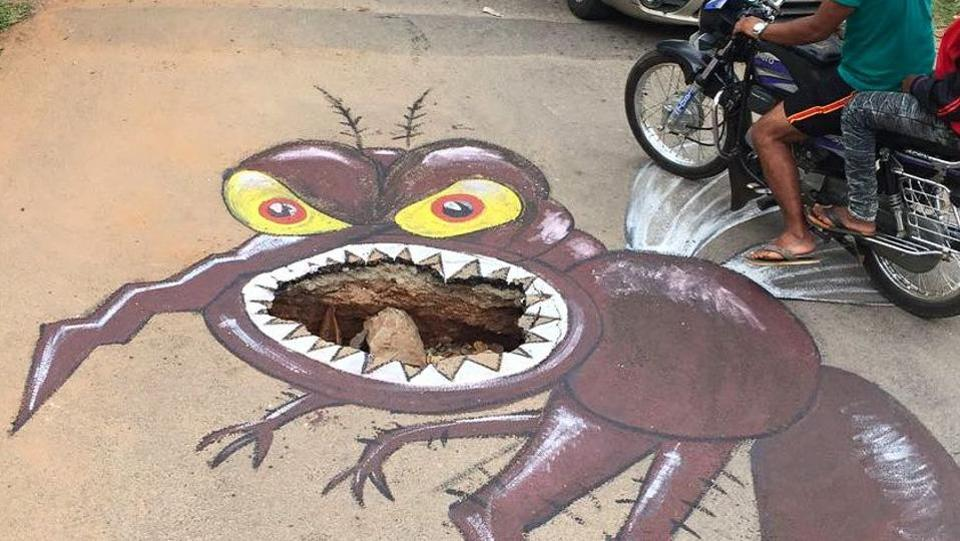 One local artist Baadal Nanjundaswamy has found a creative use for the potholes, painting elaborate murals around the craters to both beautify the city and alert motorists to danger. (Courtesy: Baadal Nanjundaswamy's Facebook page)