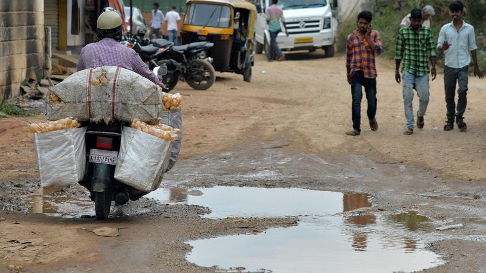 Doctors have reported a spike in patients arriving at Bangalore's hospitals with back complaints and spinal injuries sustained on the city's scarred roads.  (Manjunath Kiran / AFP)