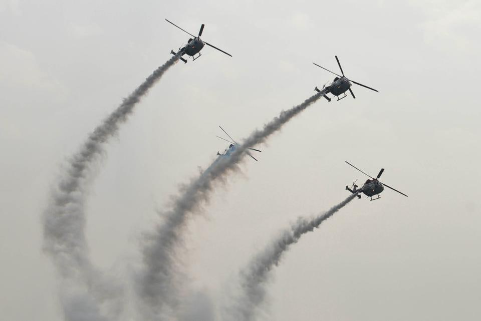 IAF helicopters displaying an air show during presentation of standards to the 117 Helicopter Unit and 223 Squadron of Indian Air Force at Adampur in Punjab on Thursday. (Pardeep Pandit/ht)