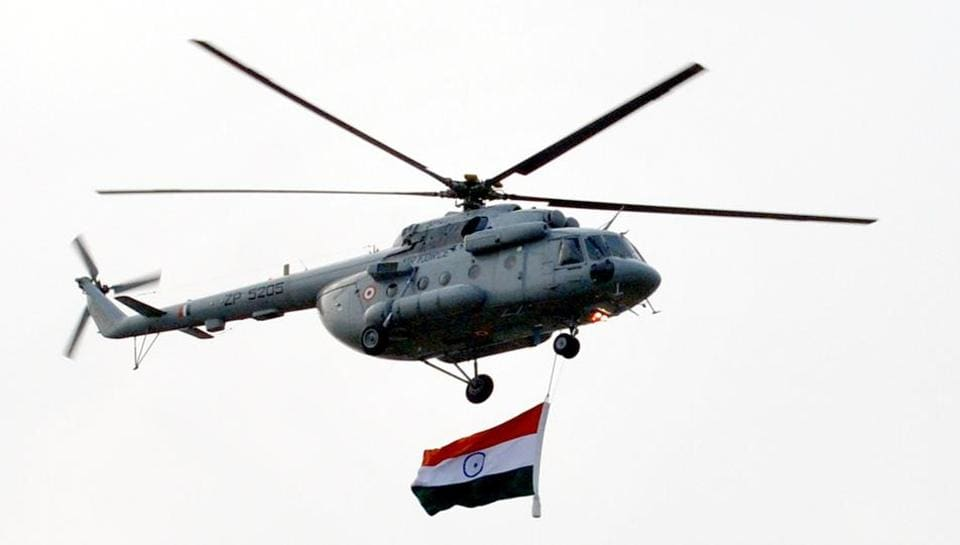 An IAF helicopter with the Tricolour during the acrobatic display in Adampur. (Pardeep Pandit/ht)