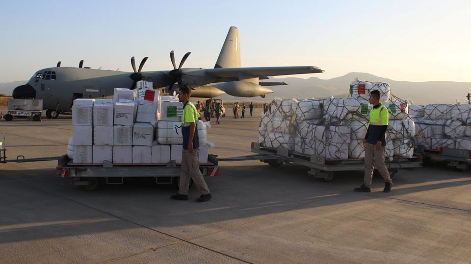 Workers unload humanitarian aid from the Italian government for Iraqi victims of the earthquake, in the semi-autonomous Kurdistan region. Israeli Prime Minister Benjamin Netanyahu too  offered aid to the victims through Red Cross  in Iran but was swift to turn the offer down as it does not recognise the Jewish state.  (REUTERS)