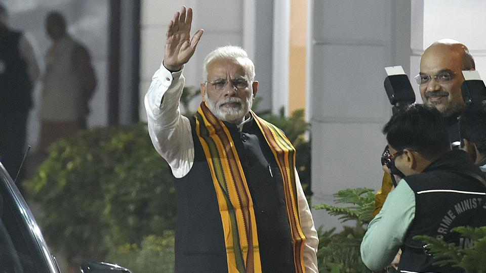 Prime Minister Narendra Modi arrives at the BJP headquarters in New Delhi for a meeting to decide ticket distribution for the Gujarat assembly elections.