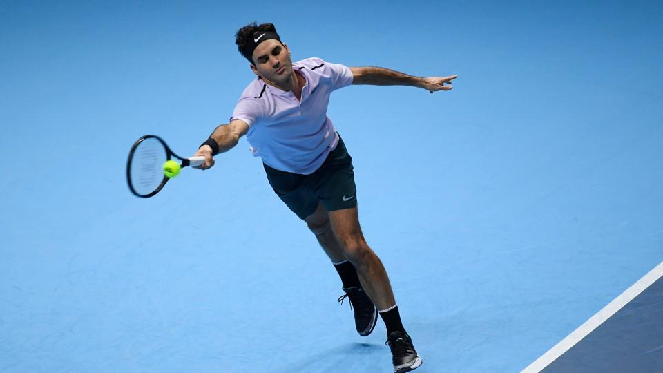 Roger Federer in action during his ATPWorld Tour Finals group stage match against Croatia's Marin Cilic. Federer wins 6-7 (5/7), 6-4, 6-1.