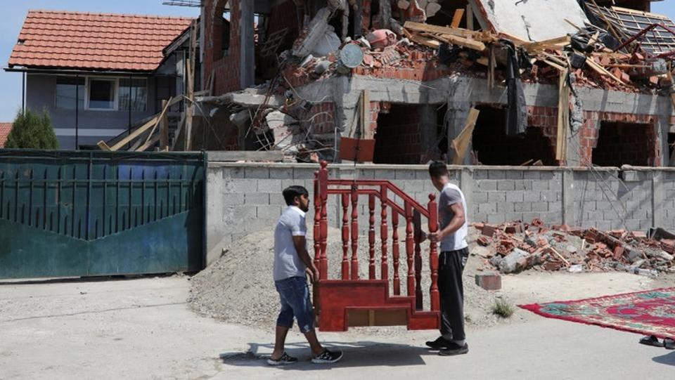 Muslims prepare to pray on a street in front of a demolished mosque in Belgrade. The Bajrakli is now Belgrade's only official mosque. This shortage was thrown into sharp relief when authorities tore down a makeshift mosque in the northern district of Zemun Polje on the eve of Ramadan in May. (Marko Djurica / REUTERS)