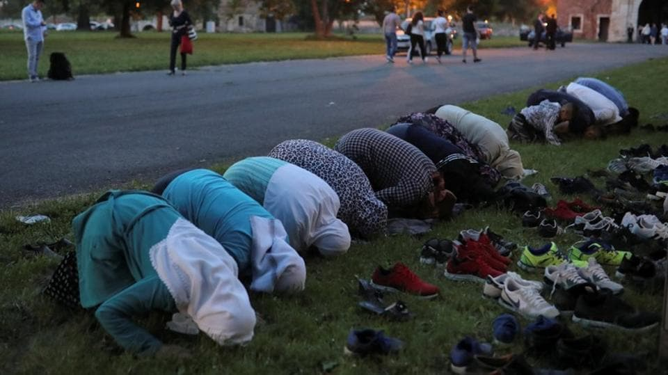 Muslim women pray in front of Kalemegdan fortress in Belgrade. Local Muslims initially came out in protest to block the demolition, but the bulldozers returned with a police escort after dark. They now gather for prayers in the house next door and in other private homes around the city. (Marko Djurica / REUTERS)