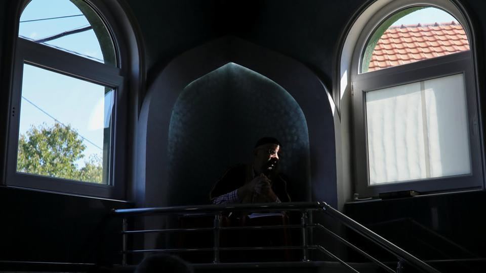 An Imam delivers a speech during  inside a makeshift mosque in Belgrade. Despite the odds, the community is determined to continue practising their religion, regardless of the obstacles. Emin Zejnulahu, mufti of the demolished mosque in Zemun Polje, said Muslims would not be deterred. (Marko Djurica / REUTERS)