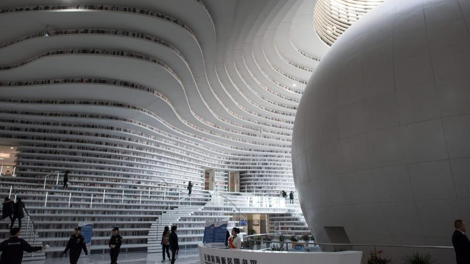 The original concept was for the upper bookshelves to be accessible via rooms behind the atrium, but a fast-tracked schedule forced MVRDV to drop the idea. Liu Xiufeng, the library's deputy director says the final plans stated that the atrium would be used for circulation, sitting, reading, and discussion, but omitted a key request to store books on shelves. (Fred Dufour / AFP)