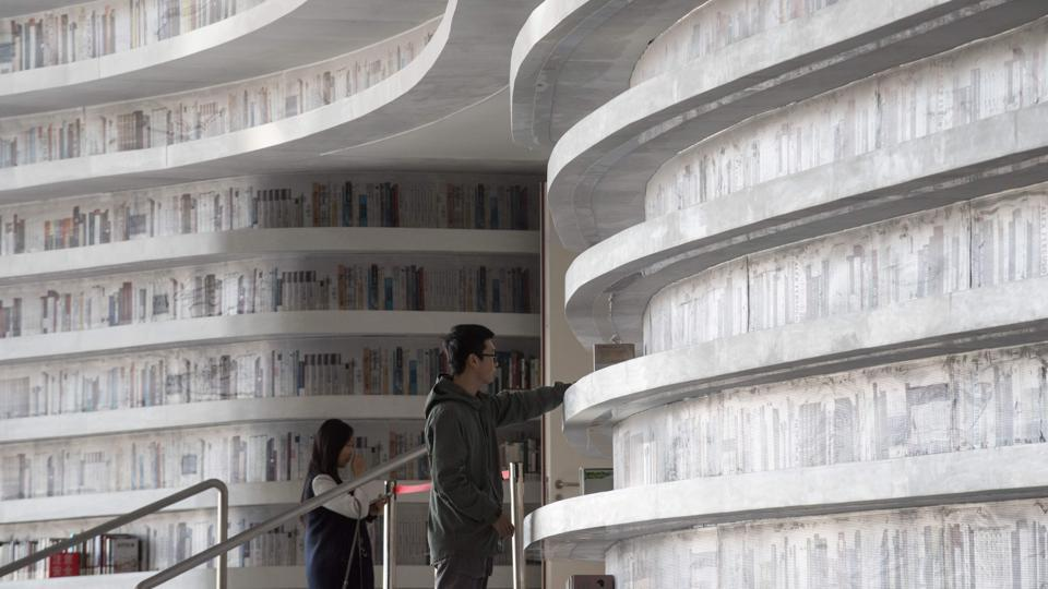 """We can only use the hall for the purposes for which it has been approved, so we cannot use it as a place to put books,"" Liu laughed, hinting that the few books that remain on shelves might also be removed soon. The Binhai library's viral image however has boosted readership, with checkouts quadrupling since the opening. (Fred Dufour / AFP)"