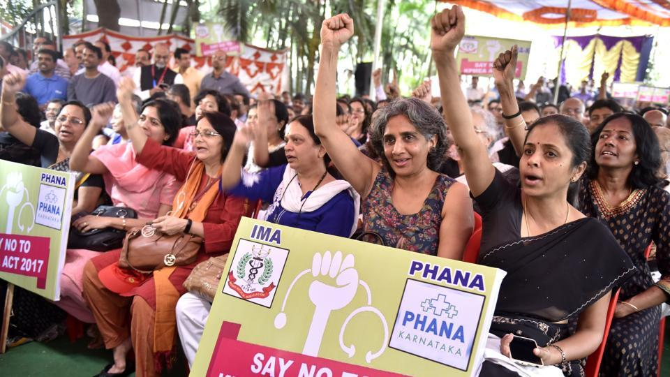 Doctors staging a demonstration outside the Indian Medical Association in protest against a contentious bill the state government proposed to table in the assembly to regulate private health sector in the state.