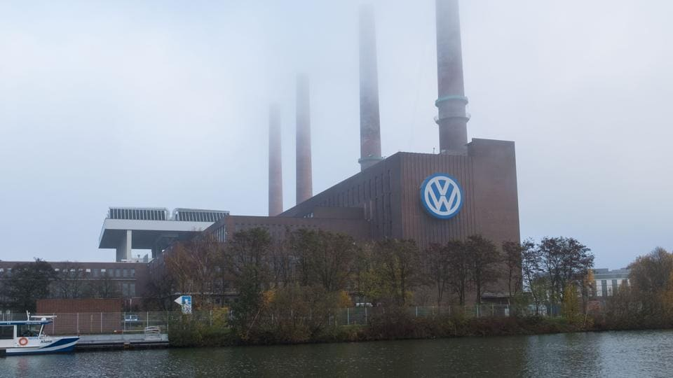 A picture taken on November 17, 2017 shows the logo of German car maker Volkswagen on the facade of the main administrative building of the Volkswagen brand at VW plant in Wolfsburg, central Germany.