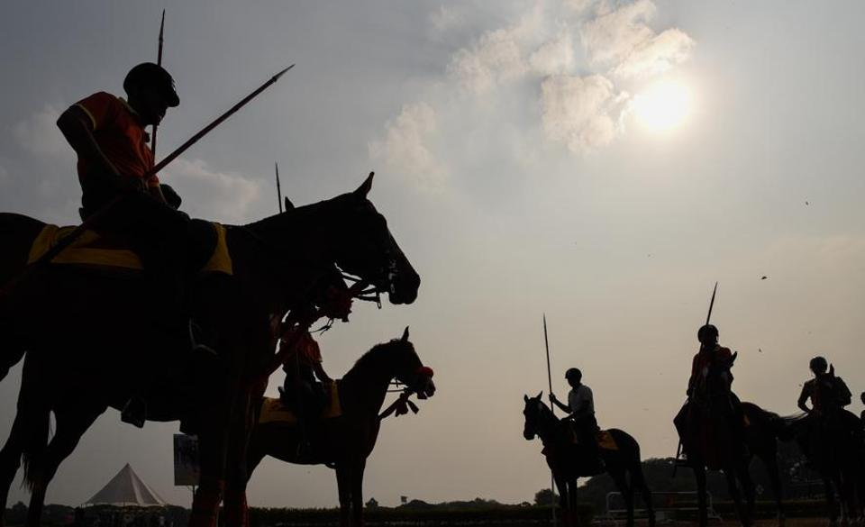 Horse riders practising tent pegging at the Southern Star Horse Show-2017 at Pune Race Course on Thursday. (Sanket Wankhade/HT PHOTO)