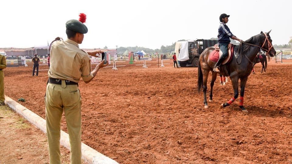 A NCC cadet takes picture of the horse rider at the Southern Star Horse Show-2017 in Pune. (Sanket Wankhade/HT PHOTO)