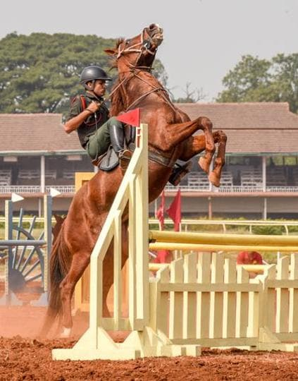 A participant makes his horse jump over a hurdle during the Southern Star Horse show at Pune Race Course on Thursday. (Sanket Wankhade/HT PHOTO)