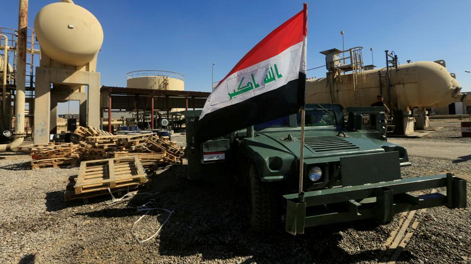 An Iraqi flag is seen on a military vehicle at an oil field in Dibis area on the outskirts of Kirkuk, Iraq October 17, 2017.