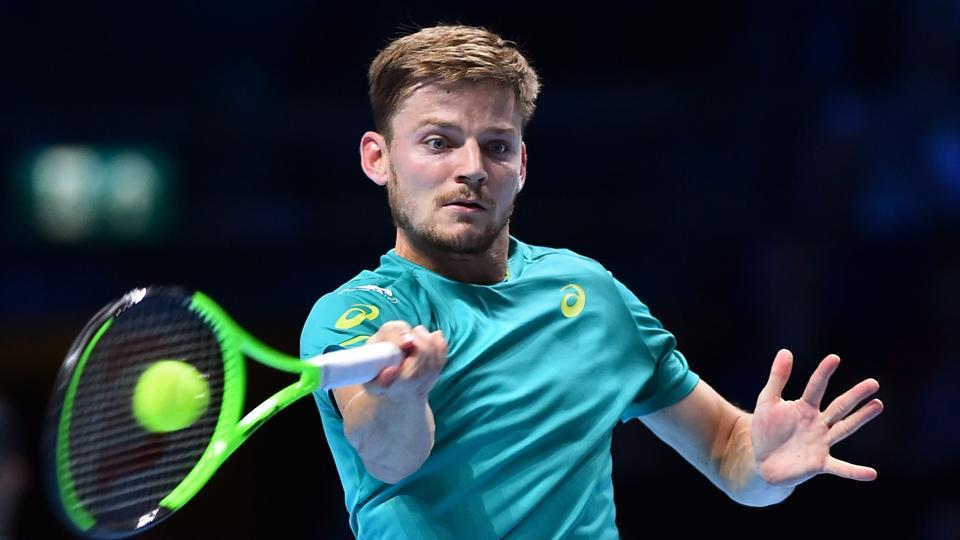 David Goffin returns to Dominic Thiem during a men's singles match at the ATP World Tour Finals.