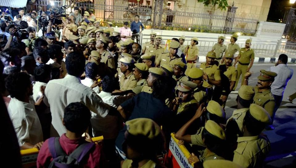 Police and media persons out side the former Tamil Nadu chief minister J Jayalalithaa's residence at Poes Garden where an IT raid was conducted on Friday night