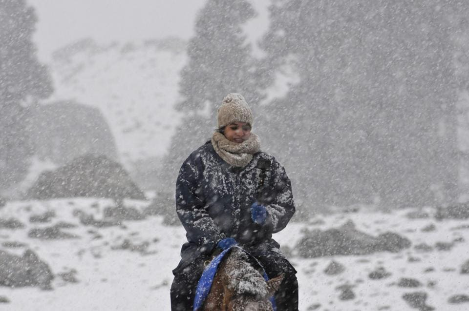 The famous ski resort of Gulmarg in north Kashmir, is experiencing snowfall at a minimum temperature of minus 3.8°C. Uri in north Kashmir also experienced fist snowfall of the season. (waseem andrabi/ht)