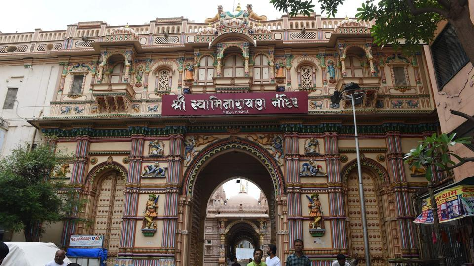 The entrance gate of the nearly 200 year old Swaminarayan Kalupur Temple in Ahmedabad. Conservation experts warn Ahmedabad, one of the world's most polluted cities, faces a mammoth task defending its newly won UNESCO status --its 600-year-old enclave was named India's first 'World Heritage City' in July-  as its fragile cultural icons decay under neglect, traffic and trash. (Sam Panthaky / AFP)