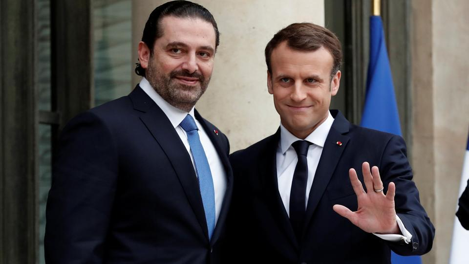 French President Emmanuel Macron and Saad al-Hariri, who announced his resignation as Lebanon's prime minister while on a visit to Saudi Arabia, react on the steps of the Elysee Palace in Paris, France, November 18, 2017.