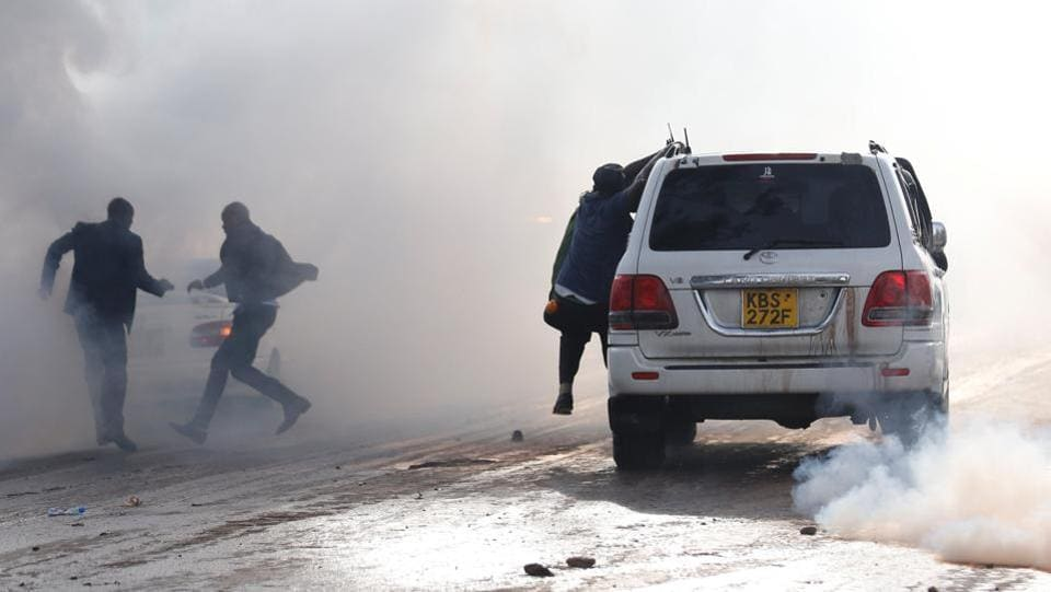Politicians run after riot police fired tear-gas to disperse the convoy of Kenyan opposition leader Raila Odinga of the National Super Alliance coalition upon his return to Nairobi. At least 5 people have been killed so far in clashes between riot police and the supporters of opposition leader. Kenyan politics has been ripped with controversies after a repeat poll was ordered by the Supreme Court citing results of the August election, won by Kenyatta, with procedural irregularities. (Thomas Mukoya / REUTERS)