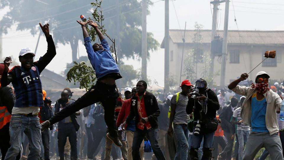 A supporter of NASA tries to catch a tear-gas fired by anti-riot police during the clashes in Kenya. Odinga had been speaking in the US and Britain about the country's political turmoil following the nullification of presidential election last month. He boycotted the new vote, saying reforms had not been made. (Thomas Mukoya / REUTERS)