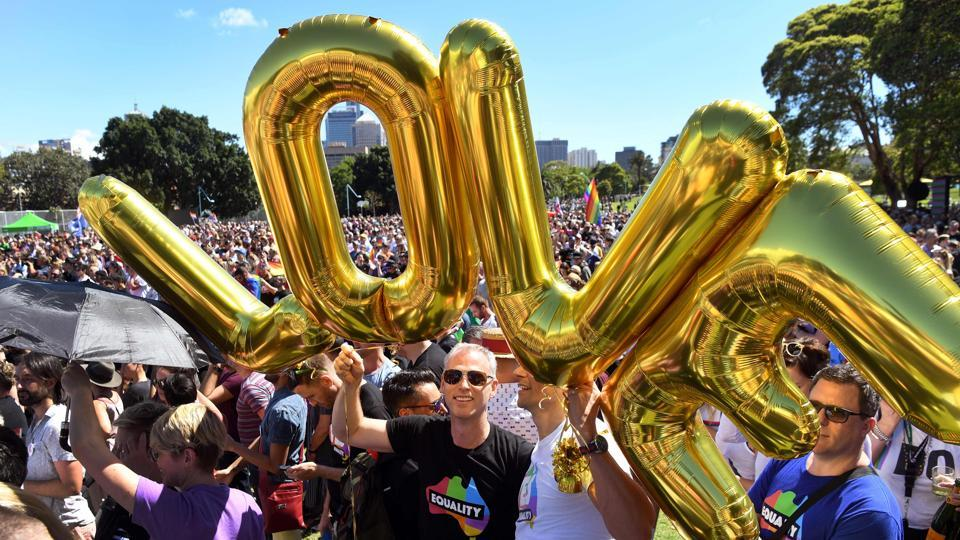 Supporters of the same-sex marriage 'Yes' vote gathered to celebrate the announcement in a Sydney park on November 15, 2017. Australians voted in favour of allowing same-sex couples to marry, official results showed on November 15, sending the task of legalising marriage equality to a deeply divided parliament. (WIlliam West / AFP)