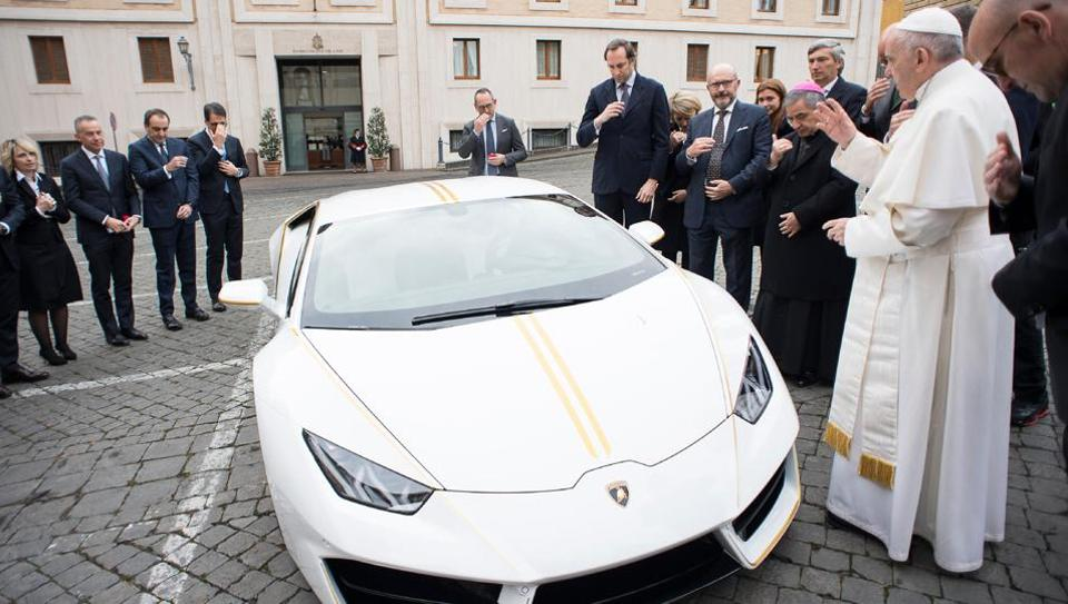 Pope Francis blesses a Lamborghini Huracan received as a gift from the Italian car company on November 15, 2017 at the Vatican. (Osservatore Romano / AFP)