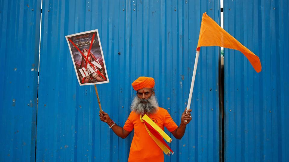 A demonstrator poses with a poster during a demonstration demanding a ban on the release of Sanjay Leela Bhansali's upcoming film 'Padmavati' in Bengaluru, Karnataka on November 15, 2017. (Abhishek N. Chinnappa  / REUTERS)