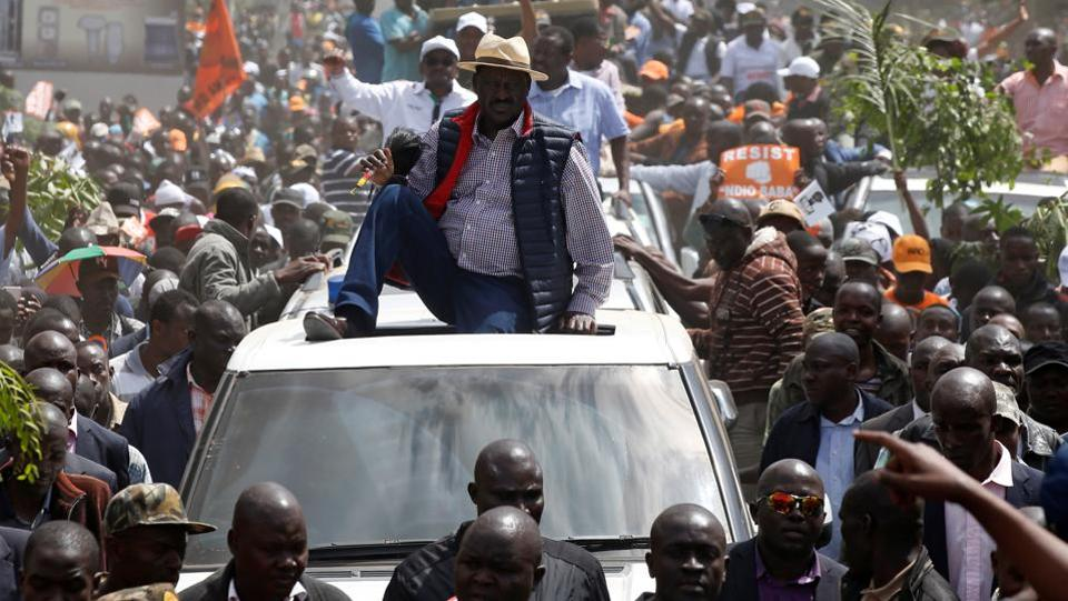 Kenyan opposition leader Raila Odinga of the National Super Alliance (NASA) coalition is welcomed by his supporters upon his return to Nairobi. Kenyatta's win last month is being challenged at the Supreme Court by activists and a politician amid claims of irregularities. The top court is expected to make a decision on Monday. (Baz Ratner / REUTERS)