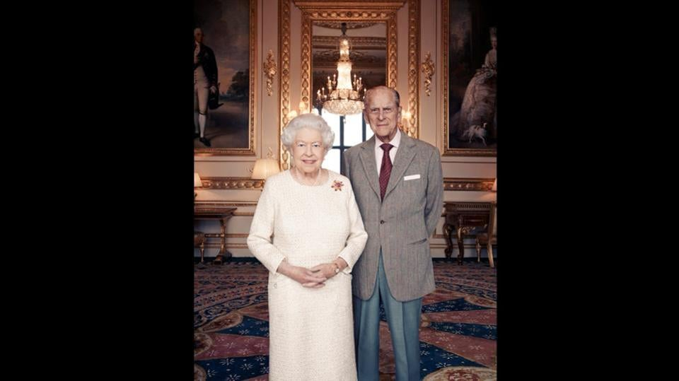 Britain's Queen Elizabeth and Prince Philip pose for a photo in the White Drawing Room at Windsor Castle, England.  Buckingham Palace issued a new photographic portrait of Queen Elizabeth and her husband Prince Philip on Saturday to mark their 70th wedding anniversary. The release of the new portrait was accompanied by the issue of a new set of six postage stamps by Royal Mail to mark the milestone. (Matt Holyoak / Camera Press via AP)