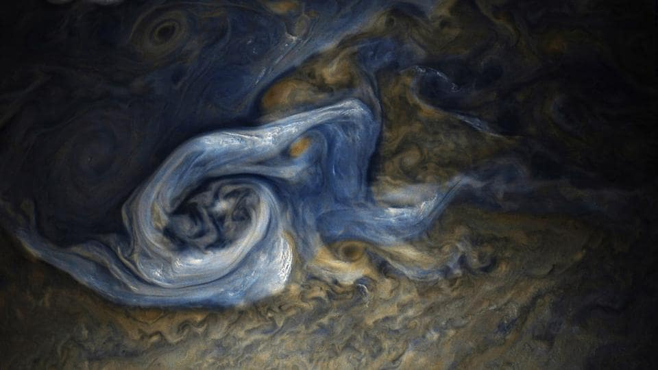 This color-enhanced image of a massive, raging storm in Jupiter's northern hemisphere was captured by NASA's Juno spacecraft during its ninth close flyby of the gas giant planet. The image was taken on October 24, 2017 at 10:32 a.m. PDT (1:32 p.m. EDT).