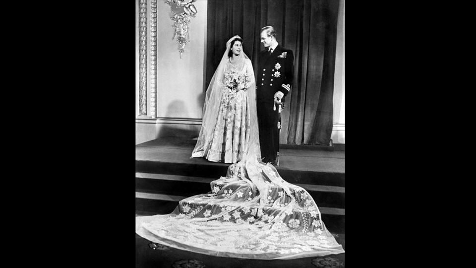 Britain's Princess Elizabeth and Philip Duke of Edinburgh pose for a photo on their wedding day, November 20, 1947 in Buckingham Palace. Seven decades on, the couple who would become Queen Elizabeth II and Prince Philip, now 91 and 96, respectively are still going strong, their marriage a bedrock in British public life amid a world of change. (AFP Photo)
