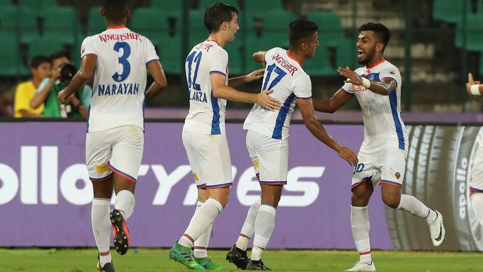 Mandar Rao Dessai of FC Goa (right) celebrates after scoring his team's third goal against Chennaiyin FC in their Indian Super League match at the Jawaharlal Nehru Stadium in Chennai on Sunday. FCGoa ran out 3-2 winners.