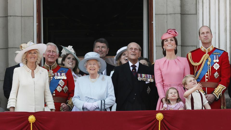 Members of Britain's Royal family from left, Camilla, the Duchess of Cornwall, Prince Charles, Princess Eugenie, Queen Elizabeth II, background Timothy Laurence, Princess Beatrice, Prince Philip, Kate, the Duchess of Cambridge, Princess Charlotte, Prince George and Prince William watch a fly past from a balcony of Buckingham Palace, after attending the annual Trooping the Colour Ceremony in London. (Kirsty Wigglesworth / AP)