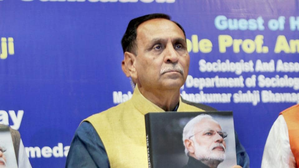 Gujarat chief minister Vijay R Rupani releases a coffe-table book on Prime Minister Modi titled 'The Making of a Legend', in Ahmedabad on November 17.