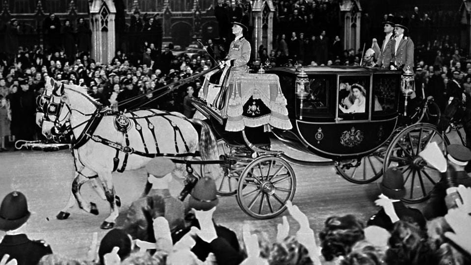 Princess Elizabeth and her husband Philip are cheered by the crowd as they travel in a coach after their wedding ceremony. Elizabeth first met Philip, a naval officer and the son of Prince Andrew of Greece, as they attended the wedding of Philip's cousin in 1934. (AFP Photo)