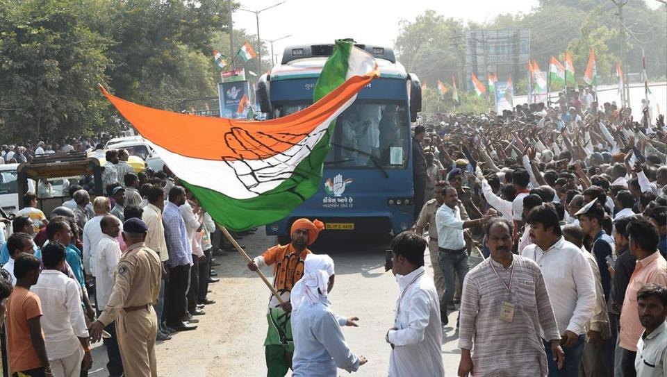 A Congress supporter waves party flag at Prantij town, some 65 kms from Ahmedabad on November 11, 2017.