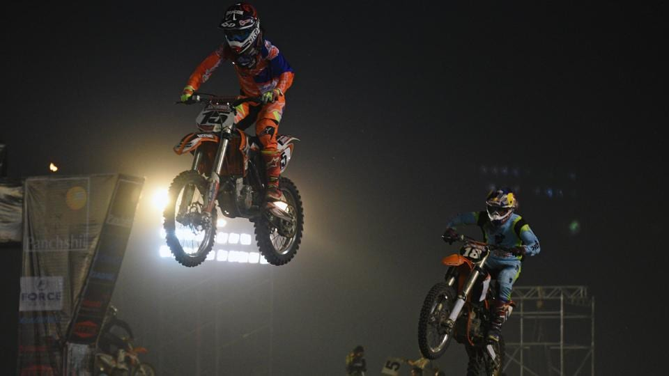 Riders during the Pune International Supercross League 2017 at Koregaon Park in Pune, on Sunday. Seven teams, 11 international, and 53 Indian riders took part in the fourth edition of the event. (Pratham Gokhale/HT Photo)