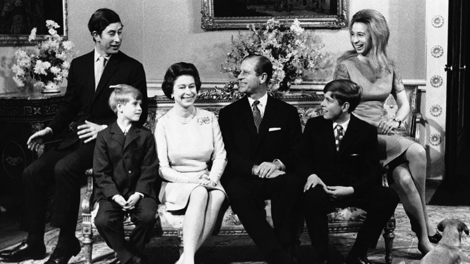 Britain's Queen Elizabeth II and Prince Philip are surrounded by family in Buckingham Palace, on the occasion of the royal couple's silver anniversary. (Seen L-R) Prince Charles, Prince Edward, the youngest child (aged 8), the Queen, Prince Philip, Prince Andrew (aged 12) and Princess Anne, (22).  (AP)