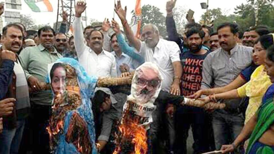 Congress workers burn effigies of Union minister Smriti Irani and filmmaker Sanjay leela Bhansali over the Padmavati row, in Jaipur.