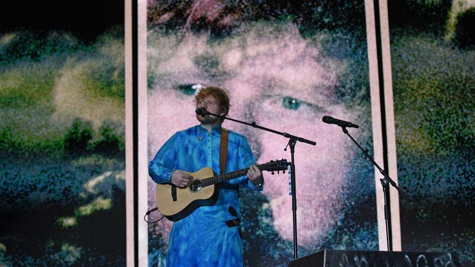 "English singer-songwriter, guitarist, and record producer  Ed Sheeran performs live at Jio Garden in Mumbai. Sheeran performed chartbusters like ""Eraser"", ""Bloodstream"" and ""Happier"" followed by ""Perfect"" with the crowd singing along at the concert. (Satyabrata Tripathy / HT PHOTO)"