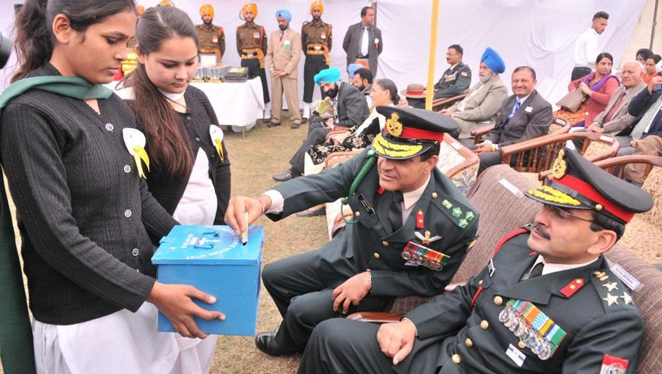 Army officers donate money to the welfare fund for family members of martyrs and retired army officials on the occasion of Armed Forces Flag Day, in Jalandhar, on December 7, 2015.